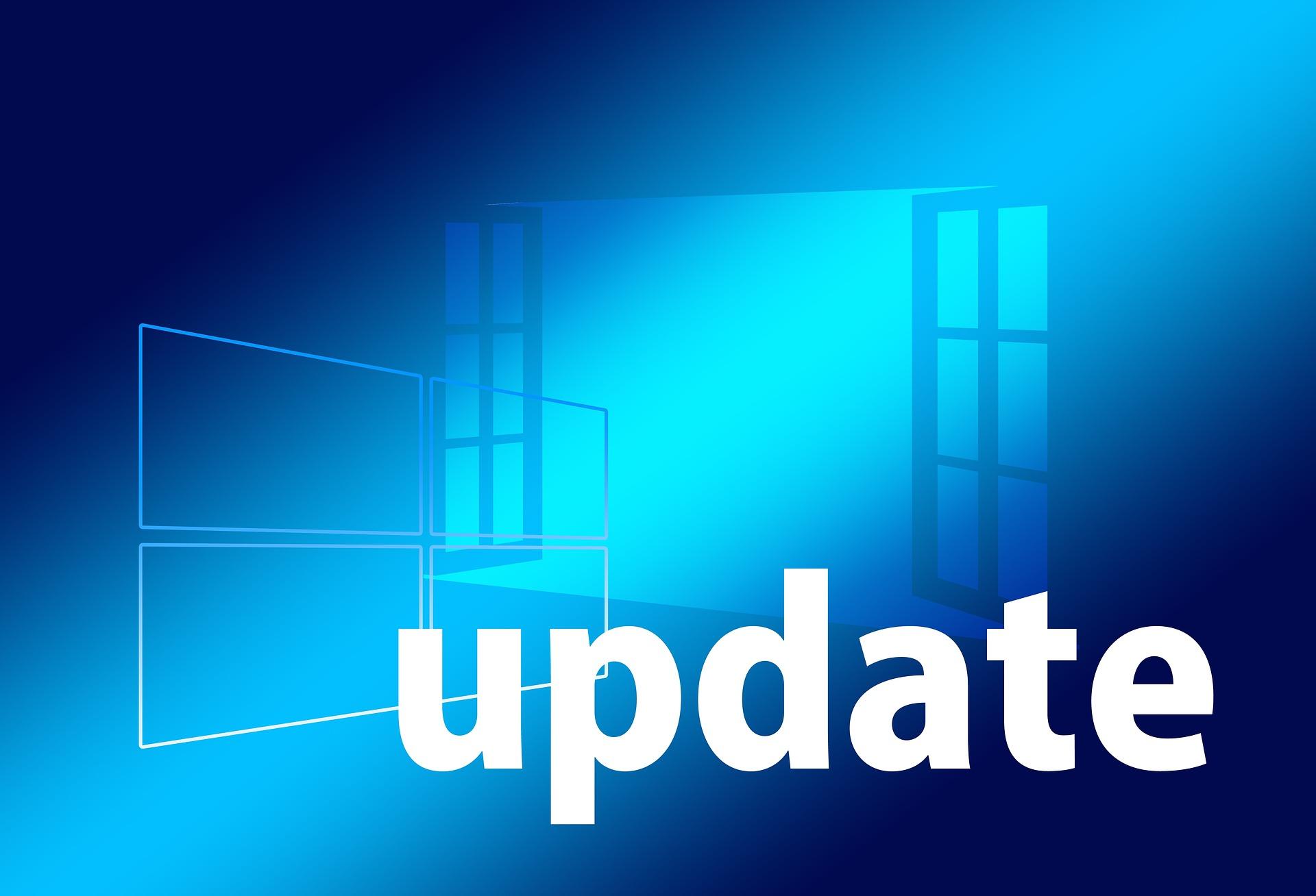 windows-ähnliches, geöffnetes Fenster auf blauem Hintergrund mit dem Wort Update